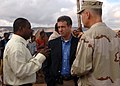 US Navy 061202-F-4925S-043 Ahmed Buh, Dire Dawa deputy mayor, speaks with Wis. Senator Russ Feingold and Rear Adm. Richard Hunt, commander of Combined Joint Task Force-Horn of Africa (CJTF-HOA), about specifics of a tent city.jpg
