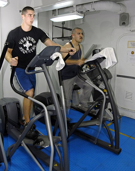 File:US Navy 070210-N-9689V-002 Damage Controlman 2nd Class Stephen Petroskey uses an elliptical trainer to test run the new cardiovascular portion of the Physical Readiness Test (PRT) aboard amphibious assault ship USS Boxer (LHD 4.jpg