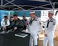 US Navy 070414-N-9274T-002 Sailors stand behind Shane Huffman, driver of the ^88 U.S. Navy Monte Carlo, as he autographs memorabilia for fans.jpg