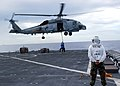 US Navy 070416-N-4021H-130 An SH-60B Seahawk, assigned to Anti-Submarine Squadron (HSL) 48, picks up pallets on the flight deck of dock landing ship USS Pearl Harbor (LSD 52) during a vertical replenishment to deliver food, med.jpg