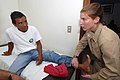 US Navy 070628-N-8704K-026 Noel Gonzales receives medical care from Lt. Gwen Smith at the Puerto Barrios National Hospital.jpg