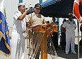 US Navy 070730-N-4021H-119 Cryptologic Technician (Interpretive) 1st Class Luis Salazar translates for the Salvadorian Chief of Naval Operations, Rear Adm. Marco Antonio Palacios during a welcoming ceremony for USS Pearl Harbor.jpg