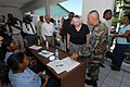 US Navy 070902-N-8704K-059 U.S. Ambassador to Haiti Janet Sanderson is guided by Senior Master Sgt. Steven Foster on a tour of Hopital De L'universite D'etat D'Haiti, where Military Sealift Command hospital ship USNS Comfort (T.jpg