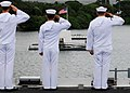 US Navy 080701-N-2638R-004 Sailors salute the USS Arizona Memorial from flight deck of the aircraft carrier USS Kitty Hawk (CV 63) as the ship pulls into Pearl Harbor for Rim of the Pacific (RIMPAC) 2008.jpg