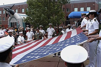 USS Bataan (LHD-5) - Sailors assigned to USS Bataan assist midshipmen in the folding of a flag flown over the World Trade Center in New York City on 11 September 2001.