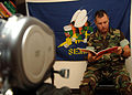 US Navy 080823-N-0981M-012 Religious Programs Specialist 3rd Class Kirk A. Cogswell reads.jpg