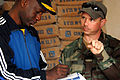 US Navy 090205-N-1688B-130 Equipment Operator 1st Class Christopher Wyeth describes the tool parts he needs to buy for the Centoe Mecico Social clinic in Dakar during an Africa Partnership Station community service project.jpg