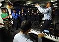US Navy 090523-N-2566C-020 Machinist's Mate 2nd Class Antonio Jenkins-Harris, acts as lead choir director for the Praise Gospel Choir as they practice in the forecastle aboard the Nimitz-class aircraft carrier USS John C. Stenn.jpg