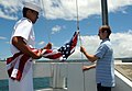 US Navy 090704-N-3666S-115 Builder Constructionman Apprentice Cleve Waiwaiole, assigned to Naval Mobile Construction Battalion (NMCB) 1, and Ethan Baatz raise the American flag over the USS Utah Memorial.jpg