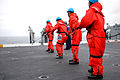 US Navy 090724-N-8960W-022 Sailors assigned to the deck department of the aircraft carrier USS Nimitz (CVN 68) heave in the phone and distance line in from the Fleet Replenishment Oiler USNS Yukon (T-AO 202).jpg