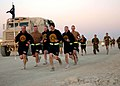 US Navy 091013-N-4440L-068 Seabees assigned to Alfa Company of Naval Mobile Construction Battalion (NMCB) 74 run with their company guidon during a 5-kilometer run at Camp Leatherneck, Afghanistan.jpg