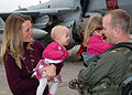 US Navy 091020-N-9860Y-005 t. Cmdr. Chris Bahner from Westminster, Md assigned to the Cougars of Electronic Attack Squadron (VAQ) 139 greets his family during the squadron's homecoming at Naval Air Station Whidbey Island.jpg