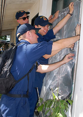 Window screen - Image: US Navy 091026 N 6692A 050 Sailors assigned to the dock landing ship USS Tortuga (LSD 46) replace a protective window screen at Kalalake Elementary School during a community service project