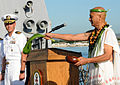 US Navy 091214-N-3666S-035 Kahu Ray Ganotise performs a traditional Hawaiian blessing while Cmdr. Michael McCartney looks on.jpg