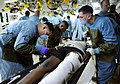 US Navy 100120-N-5345W-013 Medical personnel aboard USS Bataan (LHD 5) administer care to an injured Haitian man in the ship's medical triage.jpg