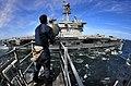 US Navy 100311-N-4774B-153 Quartermaster Seaman Matthew Rivera, from Mount Bethel, Penn., signals to Sailors aboard the aircraft carrier USS Carl Vinson.jpg