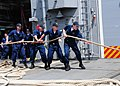 US Navy 100414-N-9301W-080 Sailors aboard the guided-missile frigate USS Klakring (FFG 42) take in mooring lines while departing St. Lucia.jpg