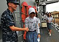 US Navy 100527-N-7643B-206 Ensign Jason Fischer thanks an Indonesian high school student for coming aboard the guided-missile frigate USS Vandegrift (FFG 48) for a tour of the ship.jpg