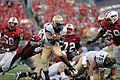 US Navy 100906-N-7647G-005 U.S. Naval Academy quarterback Ricky Dobbs (^4) rushes for a first down against the University of Maryland.jpg
