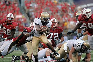 2010 Maryland Terrapins football team - Navy quarterback Ricky Dobbs rushes against Maryland.