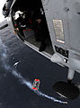 US Navy 110125-N-6632S-506 Naval Air Crewman 2nd Class Nathaniel Sniff lowers a rescue basket.jpg