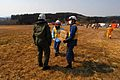 US Navy 110313-N-SB672-001 Naval Air Crewman 2nd Class Brian Fox delivers supplies to Japanese aid workers during earthquake and tsunami relief eff.jpg