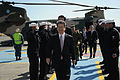 US Navy 110404-N-TO330-349 Japan Defense Minister Toshimi Kitazawa arrives on the flight line at Naval Air Facility Atsugi, Japan to receive a brie.jpg