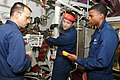 US Navy 110911-N-QL471-006 Chief Electrician's Mate Boguslaw R. Czerniak, left, Electrician's Mate Fireman Jacob M. Chriswell and Electrician's Mat.jpg