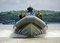 US Navy 110920-N-RI884-270 Members of a Bangladesh navy rigid-hull inflatable boat team train with U.S. Navy Sailors, right, from Riverine Squadron.jpg