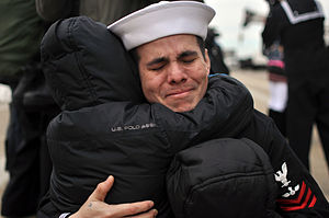 US Navy 111210-N-FU443-994 A Sailor hugs his son following the ship's return to Naval Station Norfolk.jpg