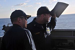 US Navy 120120-N-OP638-015 Cmdr. Martin F. Arriola, left, commanding officer of the Arleigh Burke-class guided-missile destroyer USS Porter (DDG 78.jpg