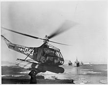 US Navy Antarctic Expedition Helicopter returns from survey of South Pole waters. The Coast Guard helicopter is shown... - NARA - 196475.jpg