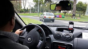 Uber (company) - An Uber ride in Bogotá, Colombia running the Uber app on his dashboard-mounted smartphone