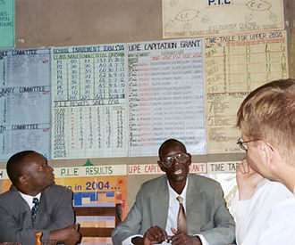 Education in Uganda - The headmaster of Nsaasa Primary School answers a question for a USAID worker.