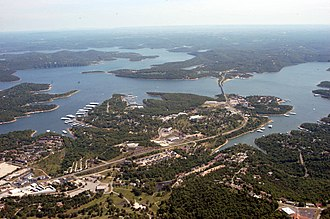 "Kimberling City, Missouri - Aerial Photo of the ""downtown"" area of Kimberling City, Missouri with the DD Highway peninsula, Point Seven, and Blue Eye in the distance and illustrating the dominance of the Main Channel of Table Rock Lake"