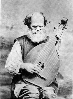 Kobza - Kobzar Ostap Veresai playing a bandura.