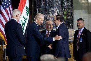 Jalal Talabani - Talabani between U.S. Vice President Joe Biden and Prime Minister Nuri Al-Maliki, 2011