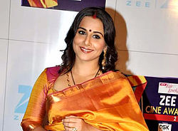 Vidya Balan is looking towards the camera