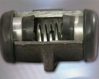 Drum brake - Cut-away section of a wheel cylinder.