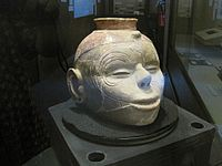 Vessel resembling a human head on display at the museum