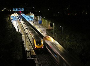 Winchester railway station - The station at night: a CrossCountry service to York passing a South West Trains service to Weymouth