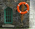 Window and life buoy, Glenveagh Castle - geograph.org.uk - 899611.jpg