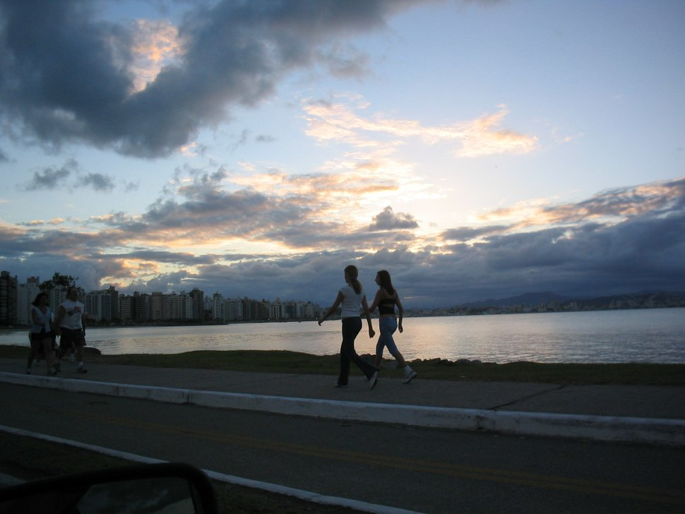 Women jogging by the water's edge, Florianópolis