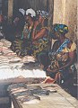 Women sells fish at a market in Gambia.jpg