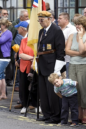 Royal Wootton Bassett - Typical group of mourners with a veteran acting as flag bearer