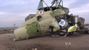 Army of Revolutionaries - Flags of the Army of Revolutionaries and the Syrian Democratic Forces on the wreckage of a Syrian Air Force aircraft in Menagh Military Airbase, February 2016.