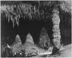 """Two people in background, 'The Rock of Ages in the Big Room,' Carlsbad Caverns National Park,"" New Mexico., 1933 - 1942 - NARA - 520049.tif"