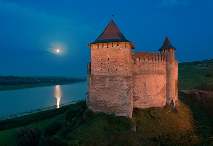Khotyn Fortress on full moon night