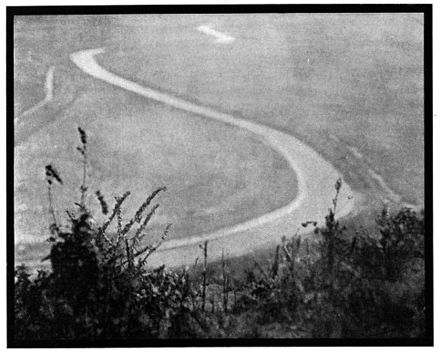Malcolm Arbuthnot: Photograph of a landscape with the meander of a river, in a pictorialist style, dated 1908