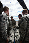 1-228th Aviation Regiment and 612th Air Base Squadron work together during crash rescue training 150115-F-ZT243-084.jpg